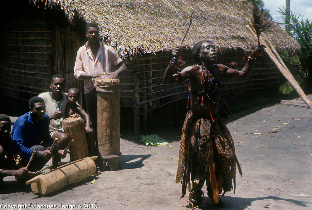 Africa, Democratic Republic of the Congo, Ngiri River area, Libinza tribe. Diviner dancing to the beat of drums.