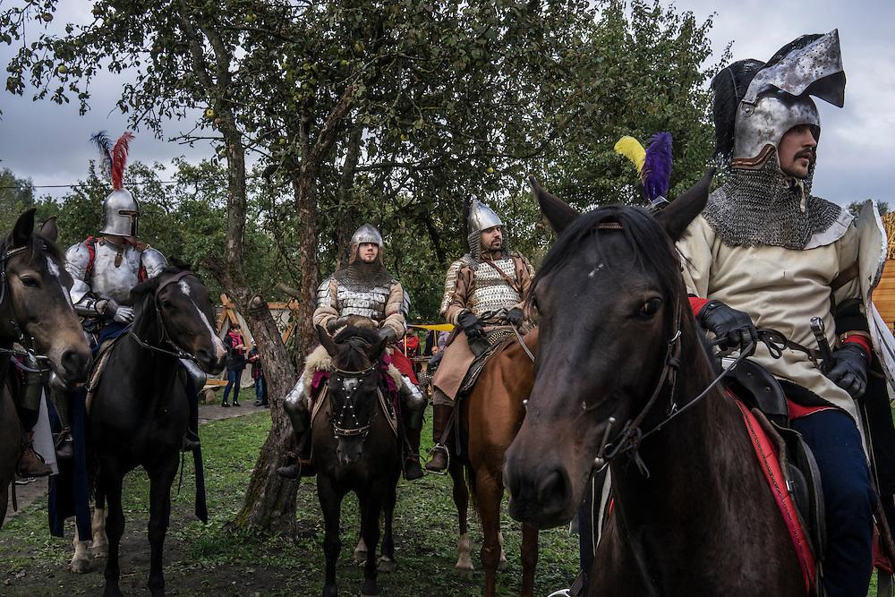 Men dressed in armor ride horses during a medieval festival on Saturday, September 24, 2016 in Mstislavl, Belarus.