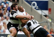 Jonathan Joseph of England (C) is tackled by Davit Kubriashvili of the Barbarians (L) and Joe Rokocoko of the Barbarians (R) during the International Test Match match at Twickenham Stadium, Twickenham<br /> Picture by Andrew Tobin/Focus Images Ltd +44 7710 761829<br /> 01/06/2014