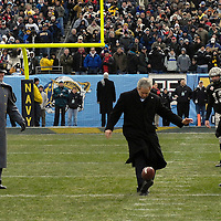 6 December 2008:   President of the United States George W. Bush kicks a football prior to the game between the Army Black Knights and the Naval Academy Midshipmen on December 6, 2008 at Lincoln Financial field in Philadelphia, Pennsylvania in the 109th Army Navy game.  Navy defeated Army 34-0 for the seventh consecutive time.