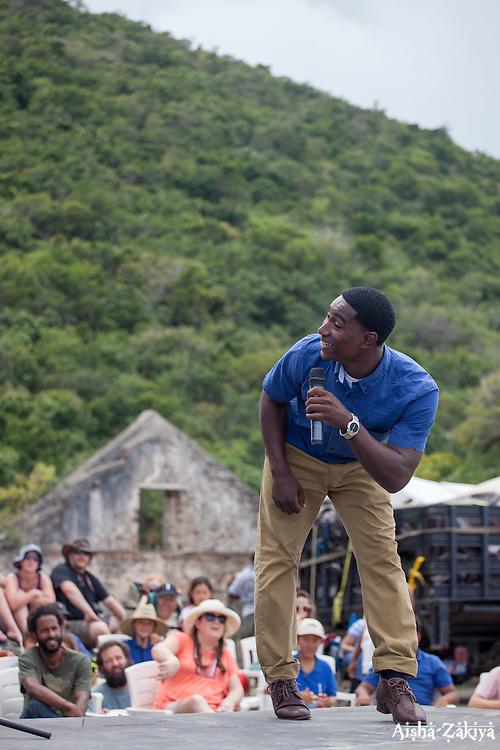 """Storyteller, Yohancé Henley entertains the audience with a story about Anansi, a Caribbean folklore character.  The Virgin Islands National Park Service presents the 26th Annual Folk-life Festival """"Celebrating Transfer Day from the Danish West Indies to the United States Virgin Islands""""  Annaberg Sugar Plantation Ruins.  23 February 2017.  © Aisha-Zakiya Boyd"""
