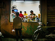 """25 DECEMBER 2017 - HANOI, VIETNAM: A man places a """"to go"""" order at the window of small restaurant in the Old Quarter of Hanoi.     PHOTO BY JACK KURTZ"""
