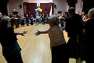 Guests joining hands to sing Auld Lang Syne at the end of a St. Andrew's dinner dance held by the Sandbach and District Caledonian Society at Sandbach Town Hall, Cheshire, England on St. Andrew's Day. Around 40 people from the Society attended the meal and dance which included a programme of Scottish country dancing. St. Andrew was the patron saint of Scotland and the day was celebrated by Scots worldwide on the 30th November.
