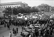 3/07/1963<br /> 07/03/1963<br /> 03 July 1963<br /> RGDATA Turnover Tax Protest March in Dublin. Picture shows the hundreds of grocers swarm to Government Buildings to present their protest to against the proposed Turnover Tax to the Minister for Finance, but  you could hear a pin drop.