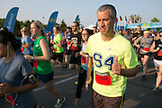 More than 10,000 runners take off from the starting line at the Corporate Challenge on the campus of RIT on Tuesday, May 24, 2016.