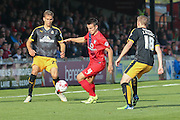Cambridge United defender, in loan from Shrewsbury Town, Mickey Demetriou  and York City midfielder James Barrett tackle for the ball during the Sky Bet League 2 match between York City and Cambridge United at Bootham Crescent, York, England on 3 October 2015. Photo by Simon Davies.
