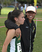 Nov 1, 2017; Long Beach, CA, USA; Sydney Carlson (left) is embraced by Natalie Mejia after placing sixth in the girls race in 19:06 during the Moore League cross country finals at Heartwell Park.