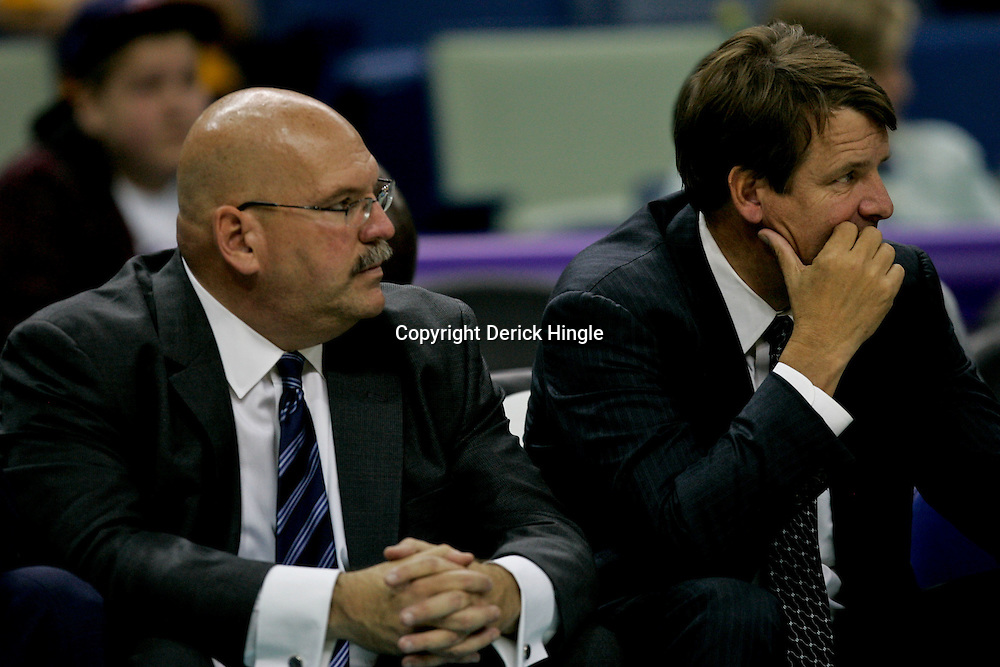 Nov 13, 2009; New Orleans, LA, USA; New Orleans Hornets head coach Jeff Bower (left) and assistant coach Tim Floyd (right) during a game against the Portland Trail Blazers at the New Orleans Arena. The Trail Blazers defeated the Hornets 86-78. Mandatory Credit: Derick E. Hingle-US PRESSWIRE