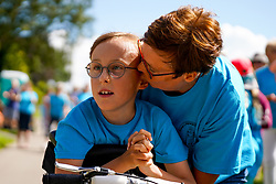 © Licensed to London News Pictures. 01/08/2020. Sheffield, UK. Tobias Weller aged 9,Sheffield, reacts after completes the final 1.2km leg of his marathon in Sheffield, South Yorkshire. Nine-year-old Tobias Weller, from Sheffield, who has cerebral palsy and autism, has raised over £100,000 for Children Hospital Charity and Paces by walking a 26.2-mile marathon during the lockdown. Tobias Weller has been inspired by WWII veteran Captain Sir Thomas Moore to take his fundraising one step ahead.<br />  Photo credit: Ioannis Alexopoulos/LNP
