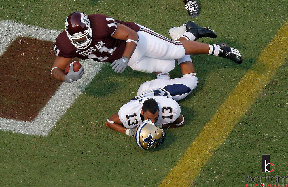 Texas A&M running back Jorvorskie Lane dives  over Montana State cornerback Kory Austin as lane scores in the second quarter on Saturday, Sept. 1, 2007. Texas A&M won the game 38-7 at Kyle Field in College Station, TX. (PHOTO BY KEVIN BARTRAM)