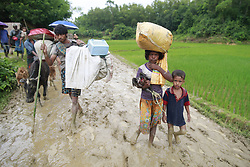September 1, 2017 - Ukhiya, Bangladesh - Members of Myanmar's Muslim Rohingya minority walk through a muddy road after crossing the Bangladesh-Myanmar border, in Ukhiya, Bangladesh. (Credit Image: © Suvra Kanti Das via ZUMA Wire)