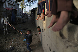 59581098 .Palestinian refugee children play in front of their family house in a poverty-stricken quarter in northern Gaza Strip town Beit Lahiya on April 28, 2013. Reports said that an increasing number of Gazan families are falling further into poverty, with unemployment rates at over 30 percent according to 2012 estimates, on April 28, 2013, 29, April 2013. Photo by: i-Images.UK ONLY