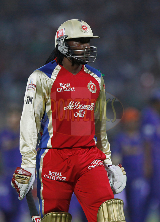 Royal Challengers Bangalore Chris Gayle walks back after getting out during match 30 of the the Indian Premier League ( IPL) 2012  between The Rajasthan Royals and the Royal Challengers Bangalore held at the Sawai Mansingh Stadium in Jaipur on the 23rd April 2012..Photo by Pankaj Nangia/IPL/SPORTZPICS