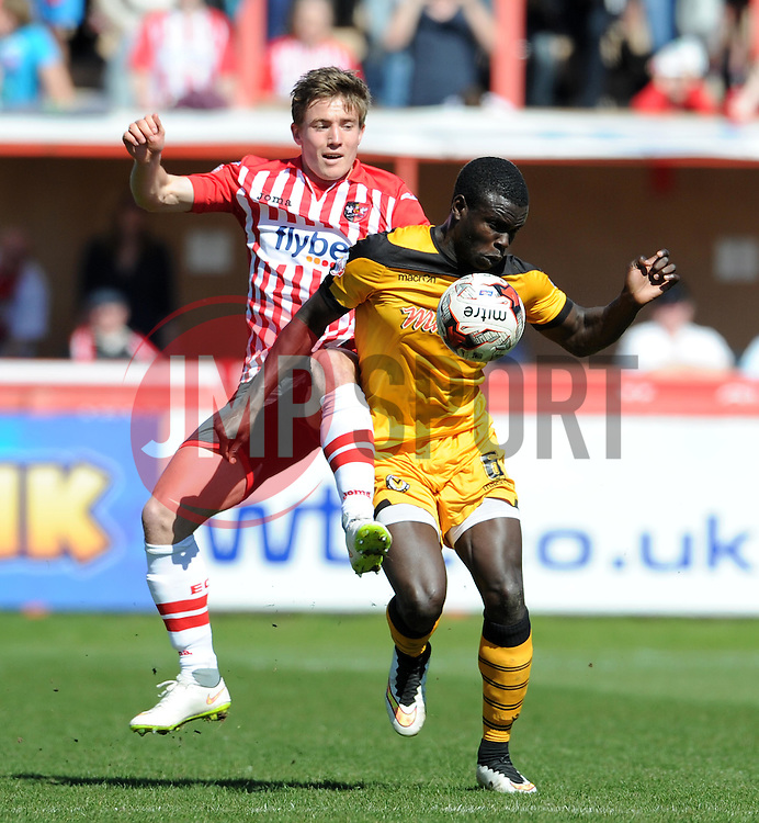 Newport County's Ismail Yakubu is tackled by Exeter City's David Wheeler - Photo mandatory by-line: Harry Trump/JMP - Mobile: 07966 386802 - 06/04/15 - SPORT - FOOTBALL - Sky Bet League Two - Exeter City v Newport County - St James Park, Exeter, England.