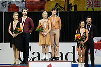 KELOWNA, BC - OCTOBER 26: Ice dance silver medalists, Madison Hubbell and Zachary Donohue of the United States, and gold medalists Piper Gilles and Paul Poirier of Canada and bronze medalists Lilah Fear and Lewis Gibson of Great Britain stand on the podium during medal ceremonies of Skate Canada International held at Prospera Place on October 26, 2019 in Kelowna, Canada. (Photo by Marissa Baecker/Shoot the Breeze)