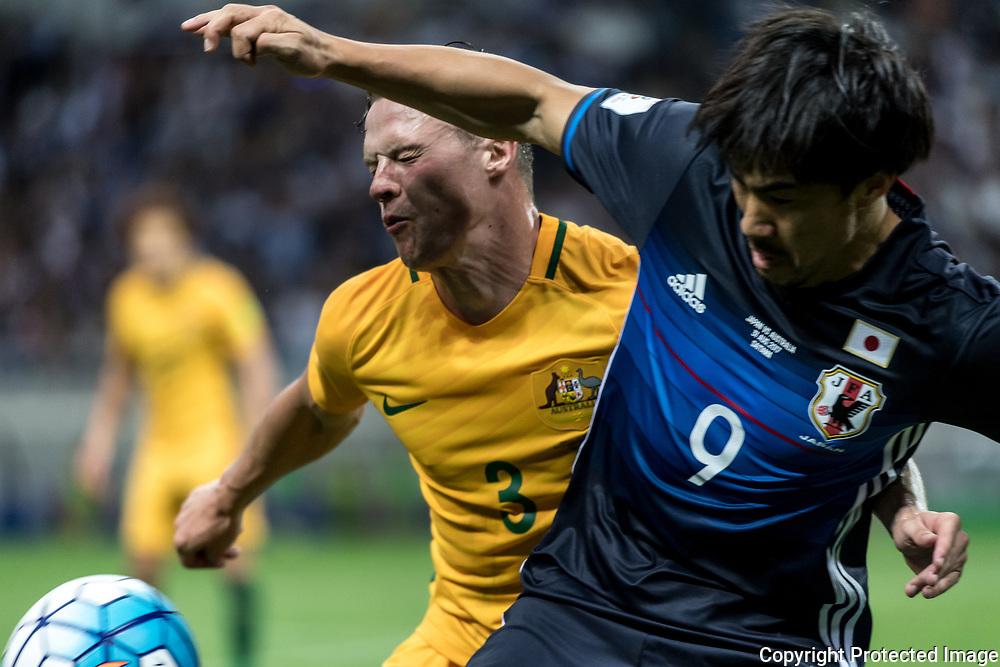 Football Soccer - Japan v Australia - World Cup 2018 Qualifier - Saitama Stadium 2002, Saitama, Japan - 31/08/17. Japan's Shinji Okazaki and Australia's Brad Smith in action. 31/08/2017-Saitama, JAPAN
