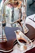 """Bellagio, Italy, Ristorante Mistral, at Villa Serbelloni Hotel, chef Ettore Bocchia.  the silver machine for the """"canard à la presse"""""""