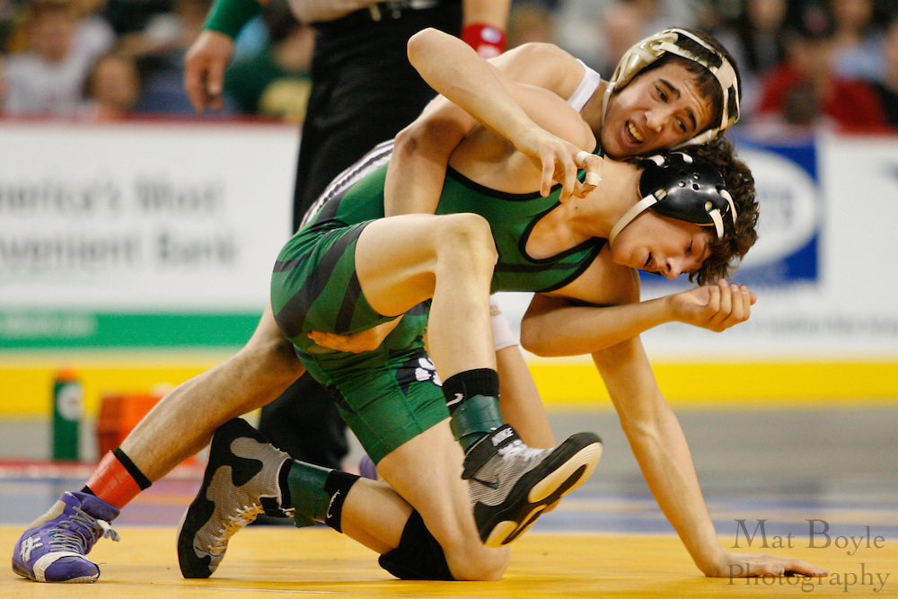 In the 112 lb. New Jersey state wrestling title match held at Boardwalk Hall in Atlantic City, Mike Magaldo of Watchung Hills (white) wrestles Anthony Ashnault of South Plainfield.