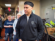 27 NOVEMBER 2019 - DES MOINES, IOWA: US Senator CORY BOOKER (D-NJ) walks through the kitchen at Central Iowa Shelter and Services in Des Moines. Sen Booker helped plate up and serve lunch at the shelter. The shelter has about 180 beds and is full almost every night. In January and February, more than 250 people per night come to the shelter, which sets out overflow bedding. Senator Booker is running to be the Democratic nominee for the US Presidency in 2020. Iowa hosts the first selection event of the presidential election season. The Iowa caucuses are February 3, 2020.      PHOTO BY JACK KURTZ