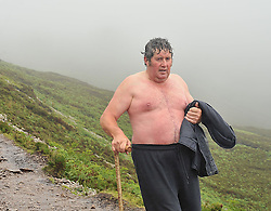 John Francis Lynn from Crossmolina makes his way back down Croagh Patrick after his early morning climb on Reek Sunday.<br /> Pic Conor McKeown