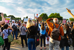Protesters watch an Osprey depart as they create a big noise in Regent's Park, London, outside the US Ambassador's residence where President Donald Trump is staying. London, July 12 2018.