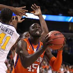 Mar 17, 2011; Tampa, FL, USA; Clemson Tigers center Jerai Grant (45) is defended by West Virginia Mountaineers forward John Flowers (41) during the first half of the second round of the 2011 NCAA men's basketball tournament at the St. Pete Times Forum.  Mandatory Credit: Derick E. Hingle