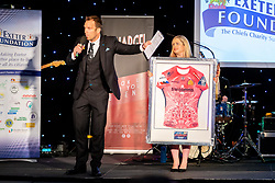 Kai Horstmann presents during the auction - Ryan Hiscott/JMP - 06/08/2018 - RUGBY - Sandy Park - Exeter, England - Exeter Chiefs Season Launch Dinner