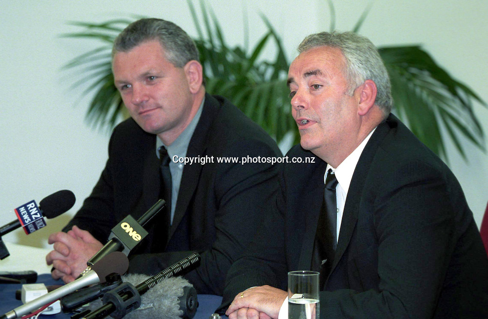 David Rutherford (l) and Murray McCaw (r) talk to the media at a NZRU press conference, 8 March, 2002. Photo: Andrew Cornaga/PHOTOSPORT