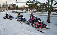 Misty, Wes and Daisy Medeiros take in an early season ride thanks to the Christmas snow that blanketed the region.   (Karen Bobotas/for the Laconia Daily Sun)