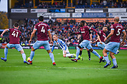 Alex Pritchard of Huddersfield Town (21) surrounded by West Ham players is fouled by Robert Snodgrass of West Ham United (11) during the Premier League match between Huddersfield Town and West Ham United at the John Smiths Stadium, Huddersfield, England on 10 November 2018.