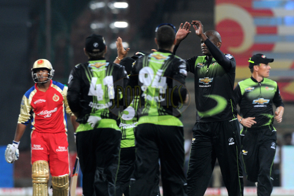 Team Warriors celebrate a wicket during match 1 of the NOKIA Champions League T20 ( CLT20 )between the Royal Challengers Bangalore and the Warriors held at the  M.Chinnaswamy Stadium in Bangalore , Karnataka, India on the 23rd September 2011..Photo by Pal Pillai/BCCI/SPORTZPICS