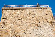 Man looking over balaustrade in San Sebastian (Spain)