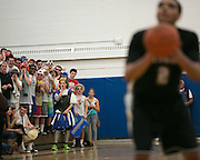 Webster Schroeder fans shout as Greece Athena's Anthony Lamb shoots a free throw during a game at Webster Schroeder High School on Friday, January 23, 2015.
