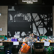 Collection point at CPH Airport tarin station.. An unprecedented number of refugees arrived from Germany in early September, most being Syrian war refugees, some from Afghanistan. Most wanted to travel on to Sweden and a number of Danish citizens created a spontanious network to assist the refugees with travel, food, clothes and psycological support.