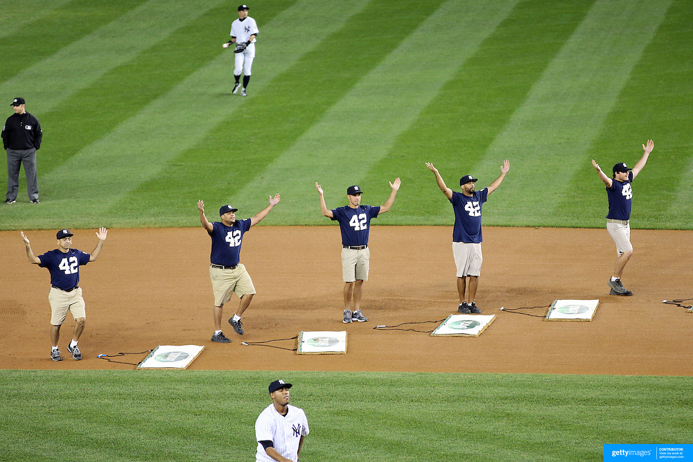 Ground staff perform YMCA wearing number 42 tee shirts during Mariano Rivera's last game at Yankee Stadium before his retirement during the New York Yankees V Tampa Bay Rays, American League baseball game at Yankee Stadium. Mariano Rivera is the last Major League player still wearing Jackie Robinson's No. 42. and holds the record for the number of saves in Major League Baseball. Yankee Stadium, The Bronx, New York USA. 26th September 2013. Photo Tim Clayton