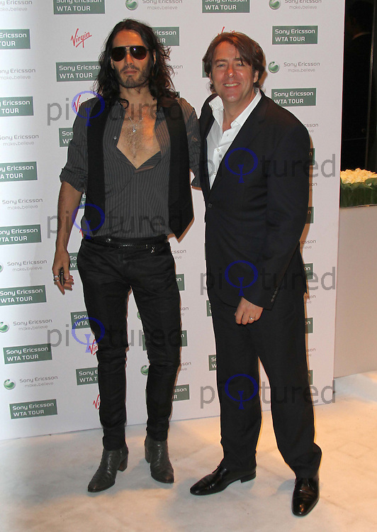 Russell Brand; Jonathan Ross World Tennis Association Pre-Wimbledon Party held at the Roof Gardens, Kensington, London, UK, 17 June 2010. For piQtured Sales contact: Ian@piqtured.com Tel: +44(0)791 626 2580 (Picture by Richard Goldschmidt/Piqtured)