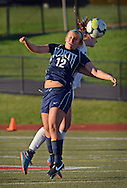 Council Rock North's Tori Hill #12 and CB East's Maddie Myrtetus  #12 head the ball in the first half of a playoff game Saturday November 14, 2015 in Souderton, Pennsylvania.  (Photo by William Thomas Cain)