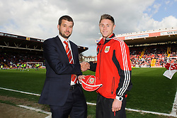 Managing director Jon Lansdown presents caps during the half time break- Photo mandatory by-line: Rogan Thomson/JMP - Tel: Mobile: 07966 386802 27/04/2013 - SPORT - FOOTBALL - Ashton Gate - Bristol. Bristol City v Huddersfield Town - npower Football League Championship.