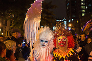 New York, NY, October 31, 2013. Two people in elaborate feathered masks in the Greenwich Village Halloween Parade.