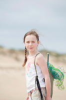 Pre-teen girl standing on beach