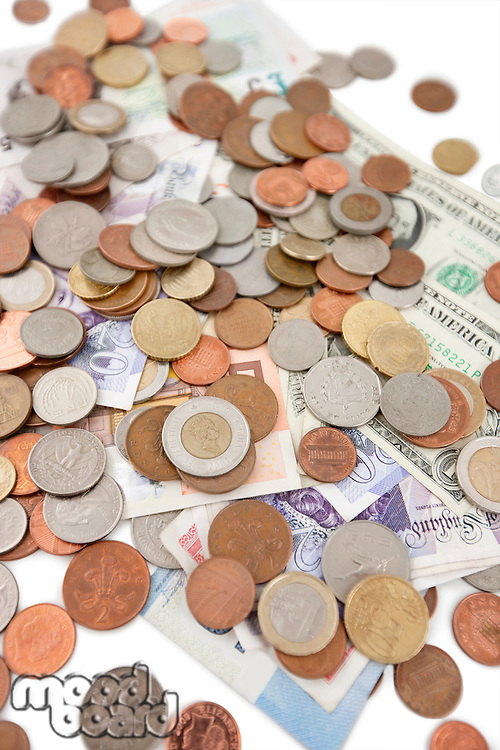 Close-up of paper currencies and coins