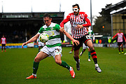 Yeovil Town's Connor Roberts and Exeter City's Alex Nicholls during the Sky Bet League 2 match between Yeovil Town and Exeter City at Huish Park, Yeovil, England on 9 April 2016. Photo by Graham Hunt.