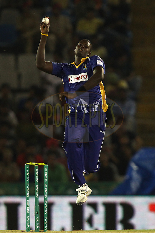 Jason Holder of the Barbados Tridents sends down a delivery during match 5 of the Oppo Champions League Twenty20 between the Kings XI Punjab and the Barbados Tridents held at the Punjab Cricket Association Stadium, Mohali, India on the 20th September 2014<br /> <br /> Photo by:  Shaun Roy / Sportzpics/ CLT20<br /> <br /> <br /> Image use is subject to the terms and conditions as laid out by the BCCI/ CLT20.  The terms and conditions can be downloaded here:<br /> <br /> http://sportzpics.photoshelter.com/gallery/CLT20-Image-Terms-and-Conditions-2014/G0000IfNJn535VPU/C0000QhhKadWcjYs