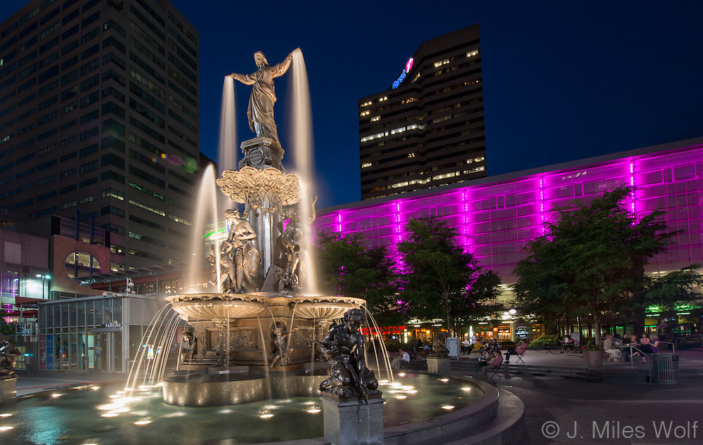 Brightly Lit Fountain Square at Twilight
