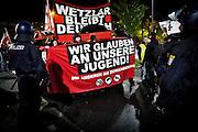 Frankfurt | 07 October 2016<br /> <br /> Am Freitag (07.10.2016) versammelten sich in Wetzlar etwa 80 Neonazis aus dem Umfeld der NPD, von neonazistischen Freien Kameradschaften, dem sog. Freien Netz Hessen und der Identit&auml;ren Bewegung zu einer Demonstration &quot;gegen &Uuml;berfremdung&quot;. Die geplante Demo-Route war von etwa 1600 Anti-Nazi-Aktivisten blockiert, daher wurde den Neonazis eine neue Demoroute durch Altstadt und Innenstadt von Wetzlar vorbei am Wetzlarer Dom zugewiesen. Auch hier stellten sich den Rechten immer wieder Aktivisten in den Weg.<br /> Hier: Aktivisten aus dem Umfeld der Neonazi-Netzwerks Freies Netz Hessen (FN Hessen) stehen vor Beginn der Demo auf einem Parkplatz am Bahnhof von Wetzlar und verstecken sich hinter Transparenten mit der Aufschrift &quot;Wetzlar bleibt Deutsch&quot; und &quot;Wir glauben an unsere Jugend&quot;.<br /> <br /> photo &copy; peter-juelich.com<br /> <br /> FOTO HONORARPFLICHTIG, Sonderhonorar, bitte anfragen!