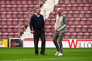 Heart of Midlothian manager Craig Levein shares a joke with Gary McAllister, assistant manager of Rangers FC on the pitch before the Ladbrokes Scottish Premiership match between Heart of Midlothian and Rangers FC at Tynecastle Park, Edinburgh, Scotland on 20 October 2019.