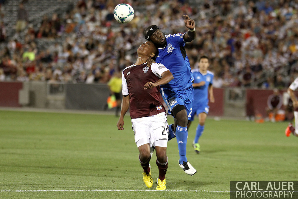 June 15th, 2013 - Colorado Rapids midfielder Jaime Castrillon (23) and San Jose Earthquake defender Nana Attakora (23) collide while both try to head the ball in the second half of action in the MLS match between San Jose Earthquake and the Colorado Rapids at Dick's Sporting Goods Park in Commerce City, CO