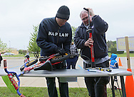 Kaplan University student advisor Aaron Mead (from left) and student William Redmond, both of Cedar Rapids, work on pumping up a tire as they make adjustments on a bike during the 2nd Annual Bike Rodeo at Kaplan University, 3165 Edgewood Parkway, in Cedar Rapids on Saturday morning, April 28, 2012. Activities included a safety talk from the Cedar Rapids Fire Department and Cedar Rapids Police Department, bike adjustments, a bike helmet giveaway, RAGBRAI themed course, and bike giveaway drawing. (Stephen Mally/Freelance)