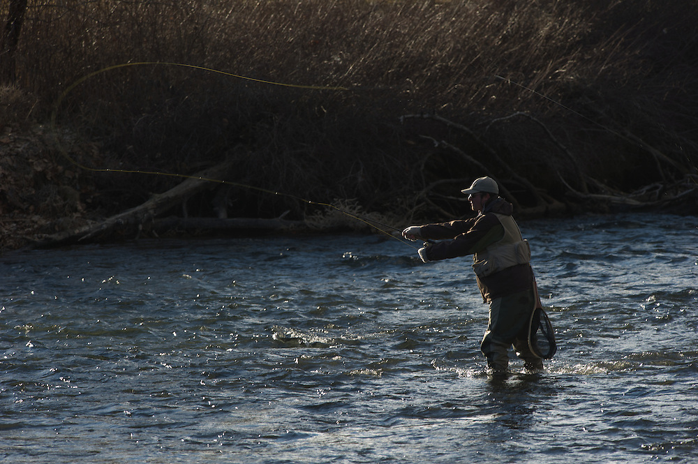 A fly fisherman cast his line along the Deschutes River.
