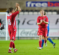 SWANSEA, ENGLAND - Friday, September 4, 2009: Wales' Christian Ribeiro celebrates after his side's 2-1 victory over Italy during the UEFA Under 21 Championship Qualifying Group 3 match at the Liberty Stadium. (Photo by David Rawcliffe/Propaganda)